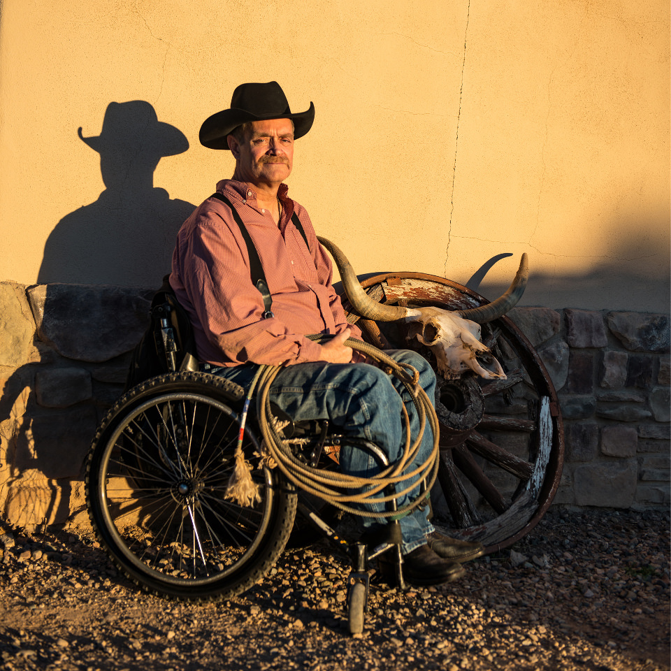 Man in a wheelchair with cowboy hat and lasso in Texas