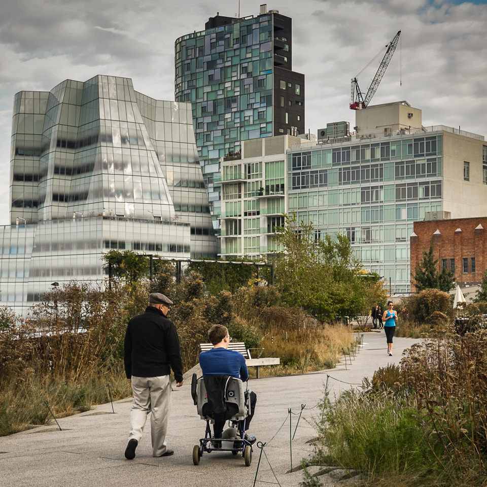 Person in a wheelchair enjoying the view as he traverses the New York City Highline